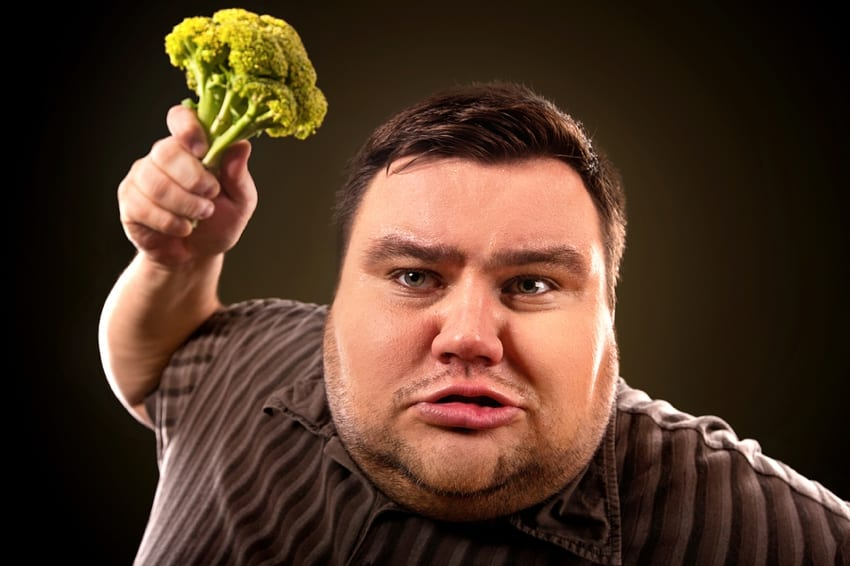 Fat man with broccoli
