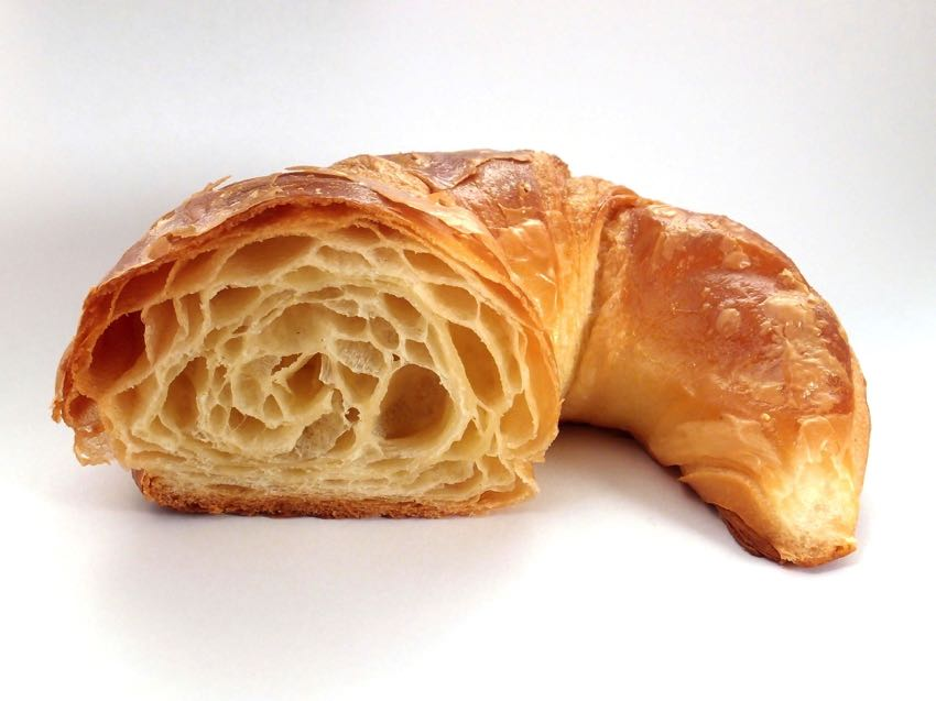 A cross section of a croissant