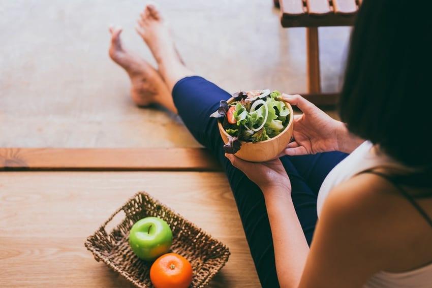 Vegan woman eating a salad