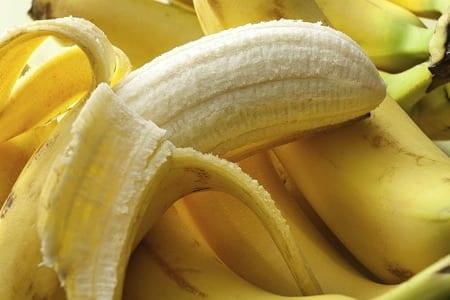 Half unpeeled banana