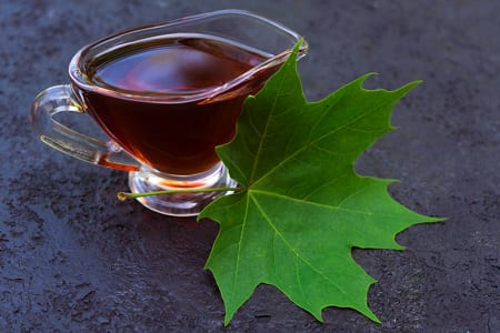 Maple syrup with maple tree leaf