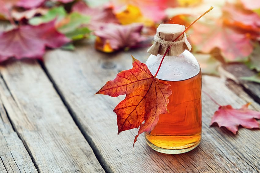 Maple syrup on autumnal table