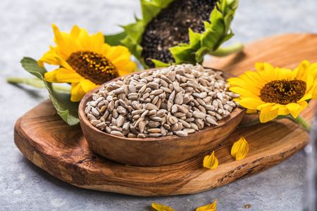 Sunflower seeds with sunflowers