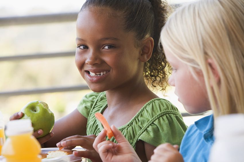 Kids eating vegan lunch at school