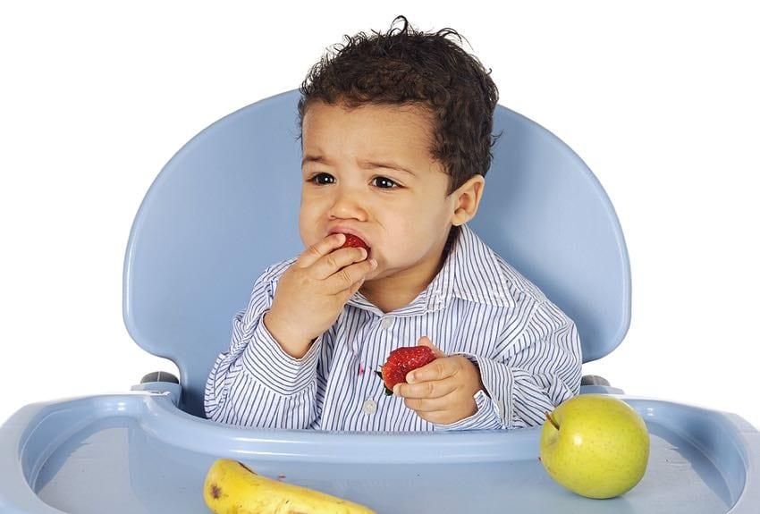 Older baby eating fruits